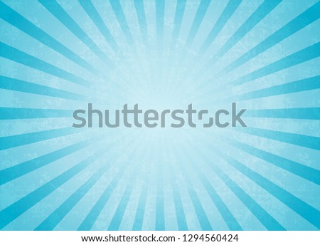 Blue background of grunge rays of light