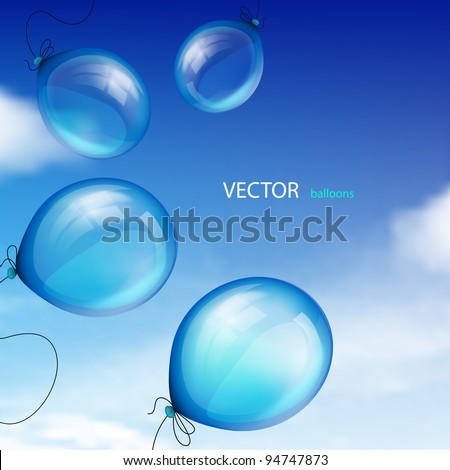 Blue balloons against sky with clouds
