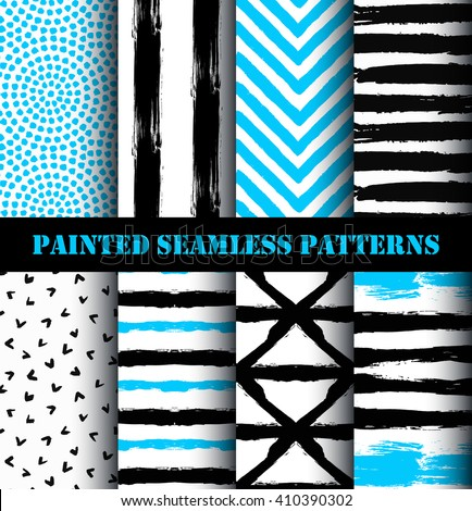 Blue black white painted seamless patterns set. Distress texture and grunge design.  Striped chevron and circle ornaments. Grunge paint backgrounds. Vector wallpaper or fabric print from brush strokes