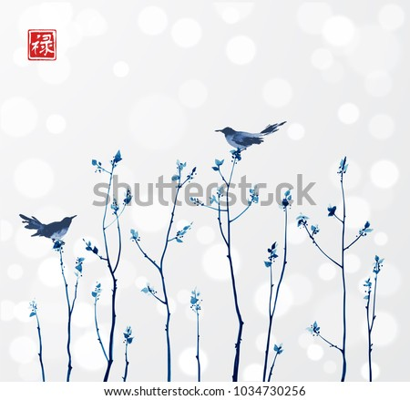 blue branches with fresh leaves