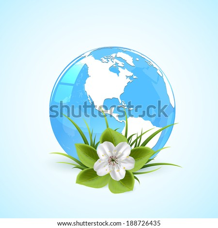 blue globe in grass with flower
