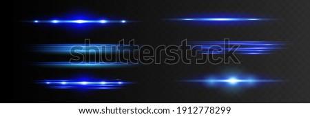 Blue horizontal lens flares pack. Laser beams, horizontal light rays. Beautiful light flares. Glowing streaks on dark background.