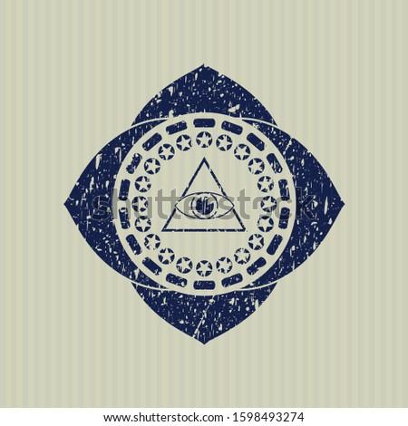 Blue illuminati pyramid icon inside distressed rubber grunge stamp