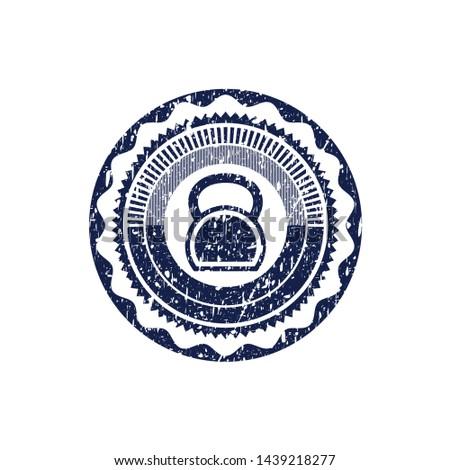 Blue kettlebell icon inside rubber grunge seal