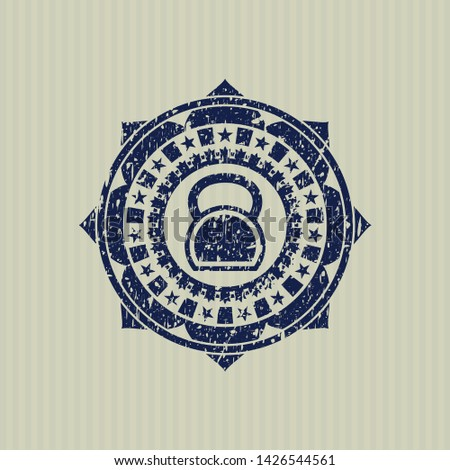 Blue kettlebell icon inside rubber stamp with grunge texture