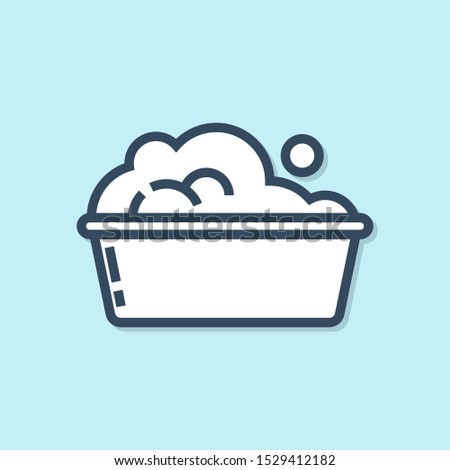 Blue line Plastic basin with soap suds icon isolated on blue background. Bowl with water. Washing clothes, cleaning equipment.  Vector Illustration