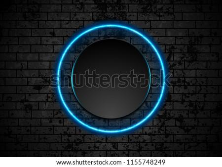 Blue neon circle on grunge brick wall background. Vector retro design