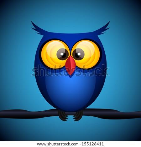 blue owl on the dark background