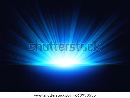 blue rays rising on dark...
