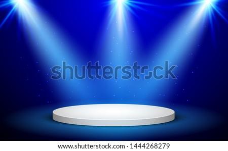 Blue Round Winner Podium on blue Background. Stage with Studio Lights for Awards Ceremony. Spotlights illuminate. Vector illustration.