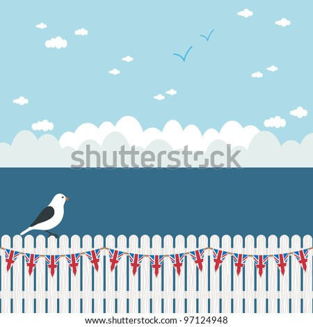 blue seascape with perched seagull on white picket fence with union jack bunting