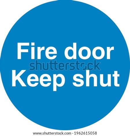 Blue sign board Fire door keep shut Stock photo ©