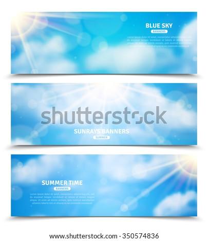 blue sky with sun rays trough