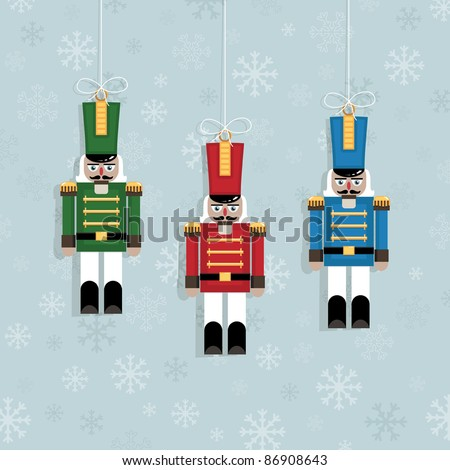 blue snowflake background with hanging christmas nutcracker soldier ornaments