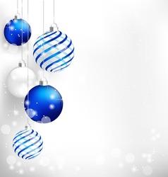 Blue spiral christmas balls hang on white background