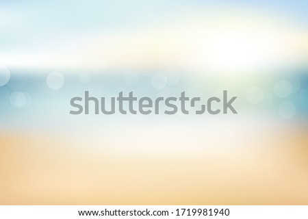 Blur beach and sand abstract background with bokeh sun light  for summer.