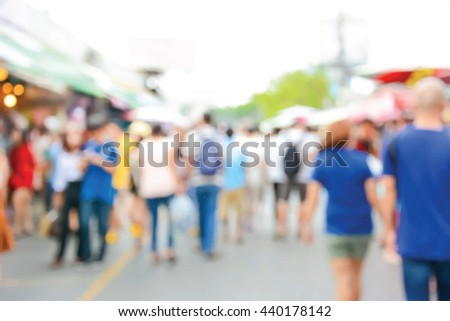 Blur people wearing colorful clothes in walking street - vector abstract background #440178142