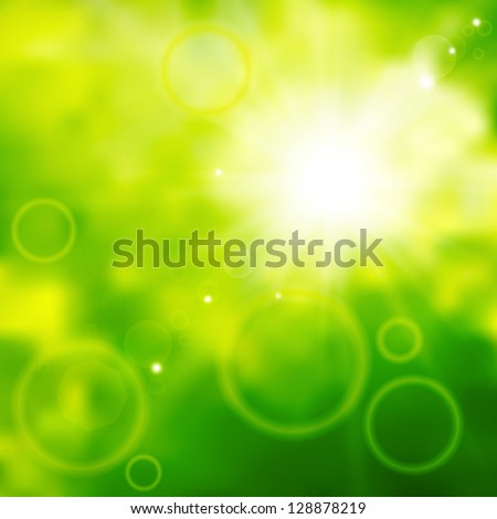 Blurred background of green color with sun beams
