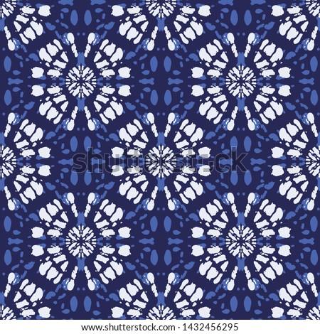 Boho Monochrome Indigo Blue Tie-Dye Shibori Mirrored Sunburst Mandala Background Vector Seamless Pattern. Perfect for Spring-Summer Textiles, Stationery