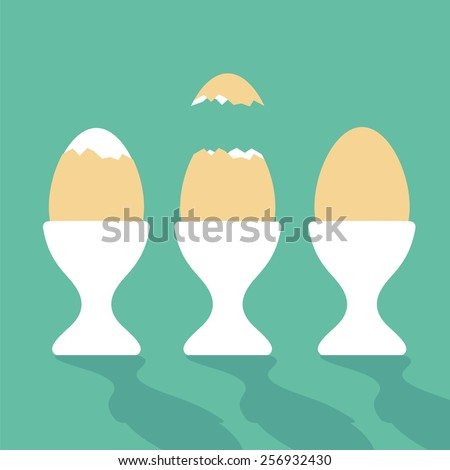 boiled eggs in egg cups   three