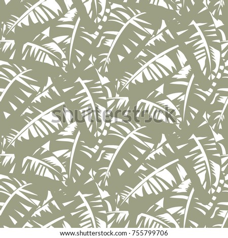Bold abstract jungle print with silhouette of paradise island foliage. Vector seamless floral green pattern inspired by tropical nature and plant with shape of banana leave and tree. Summer background