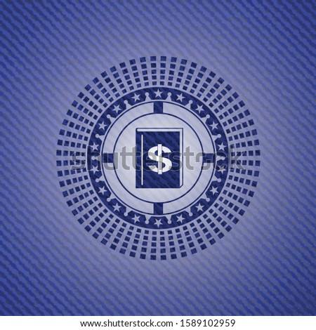 book with money symbol inside icon inside denim background