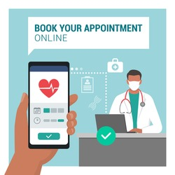 Book your medical appointment online using a mobile app, doctor sitting at desk in the background and wearing a face mask