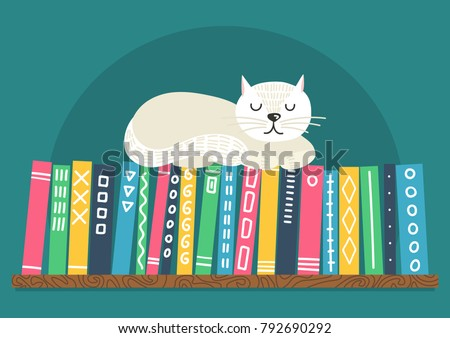 books on shelf with white cat