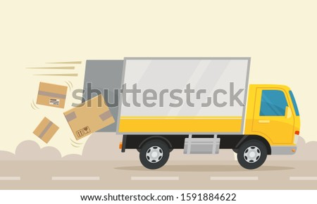 boxes fall from truck as the
