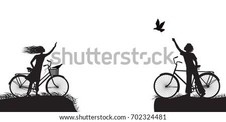 boy and girl on bicycle waving