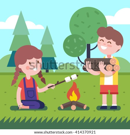 boy brings some firewood at the