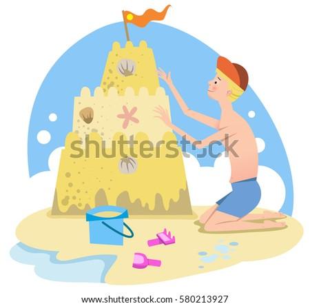 boy building a sand castle on