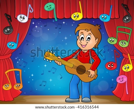 boy guitar player on stage