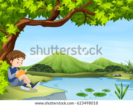 Boy reading by a pond
