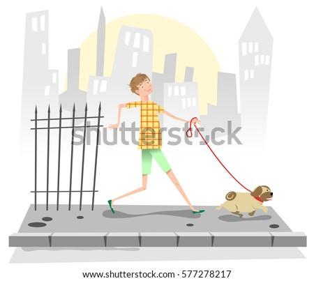 boy walking a pug on a sidewalk ...