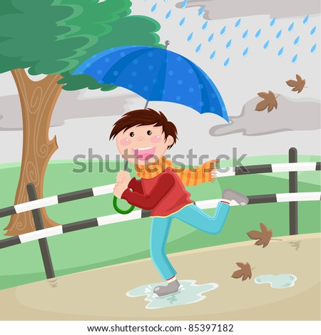 boy with umbrella running in