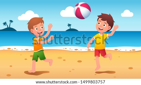 boys kids playing beach ball at