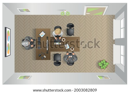 Brainstorming team. Boss office. Top view. Positive communication of colleagues. People have a conversation. Boss gives instructions to subordinate sitting at a table. Foto stock ©