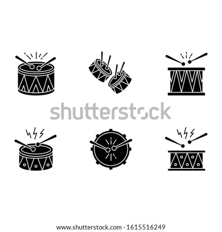 Brazilian music black glyph icons set on white space. Drums with drumsticks. Samba. Musical instrument. Brazilian carnival. Festive drum parade. Silhouette symbols. Vector isolated illustration