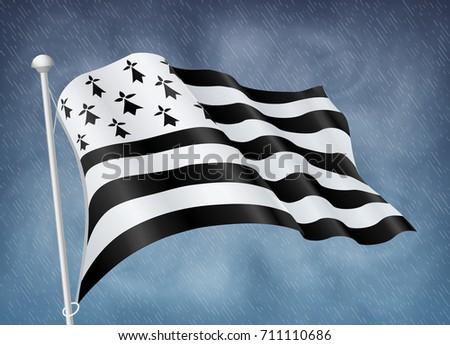 breton flag on wind with rainy