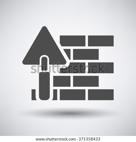 brick wall with trowel icon on