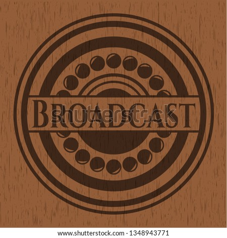 Broadcast badge with wooden background
