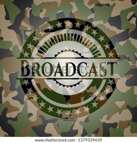 Broadcast written on a camouflage texture