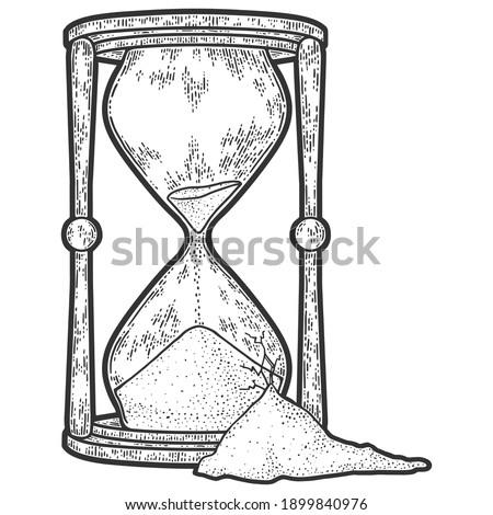 broken hourglass engraving