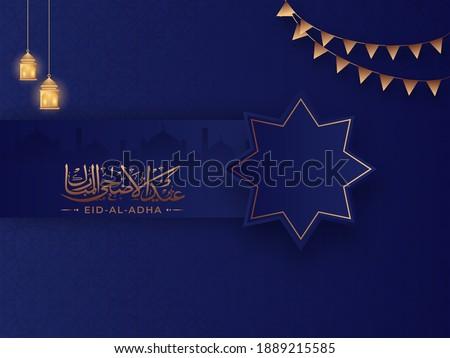 Bronze Arabic Calligraphy of Eid-Al-Adha with Rub El Hizb Symbol, Hanging Illuminated Lanterns and Bunting Flags on Blue Islamic Pattern Background.