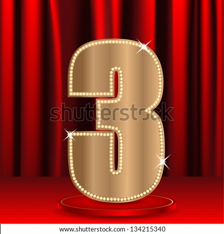 bronze number three decorated by brilliant stones on a background a red curtain