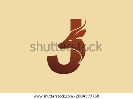 Brown color of J initial letter with deer head design Foto stock ©