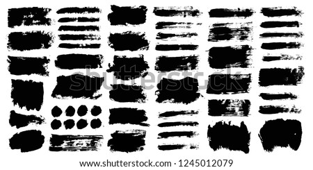 Brush strokes. Vector paintbrush set. Round grunge design elements. Long text boxes. Dirty distress texture banners. Ink splatters. Grungy painted objects. #1245012079