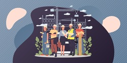 Builders, architect, engineer, foreman standing together. Positive professional team in hardhats with blueprints and tools working on construction site. Building works, job concept