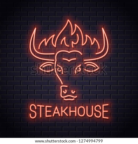 Bull head neon logo of steakhouse. Bull horn with fire neon sign on wall vector background